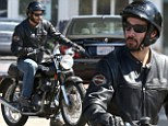 Easy rider: Keanu Reeves takes his motorcycle for a spin in Malibu