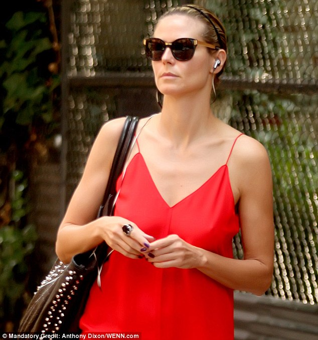 Turning heads: Heidi wore headphones as she went shopping in Soho, New York, earlier in the day