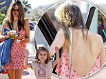Alessandra Ambrosio bares her back in flirty pink dress...as little Anja pulls faces