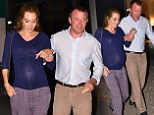 Blossoming along beautifully: Guy Ritchie dotes over pregnant girlfriend Jacqui Ainsley following a date night