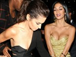 Trying to upstage her again? Nicole Scherzinger shows up to Cheryl Cole's concert after-party baring more cleavage than the leading lady