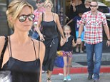 Heidi Klum stills looks runway ready... as she juggles children and kitchenware shopping with bodyguard boyfriend