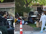 Rancid: Junk is piled high outside the home of Kenneth Epstein in Las Vegas after authorities finally fought their way in on Friday