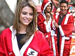 In the red corner! Extra host Maria Menounos shows off boxing robe... as Mario Lopez is presented early birthday cake
