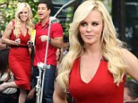 Scarlet woman! Jenny McCarthy charms Extra's Mario Lopez after donning red dress