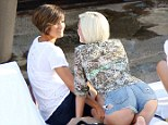 Frankie Sandford lounges by the pool in Hollywood with sister Victoria in a pair of tiny shorts