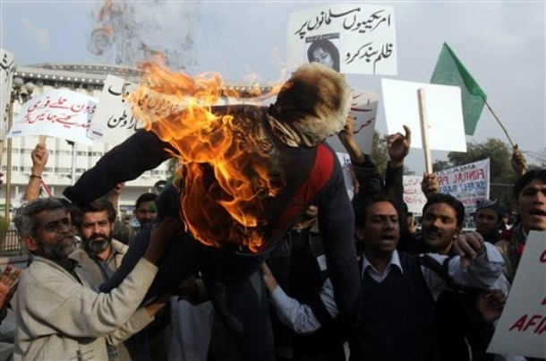 Pakistani protester burn the effigy of U.S. President Barack Obama during a rally to condemn the verdict against accused al-Qaida associate Aafia Siddiqui, Sunday, Feb. 14, 2010 in Lahore, Pakistan. Siddiqui, 37, was convicted of two counts of attempted murder, though the jury found the crime wasn't premeditated.