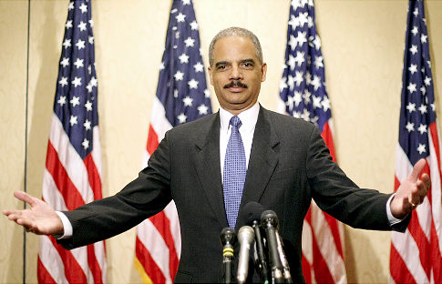 U.S. Attorney General Eric Holder responds to reporters' questions following the arrest of Pakistani-American Faisal Shahzad late Monday night.