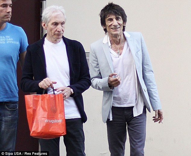 Reunion: Charlie Watts and Ronnie Wood were spotted together outside a recording studio in Paris earlier this month