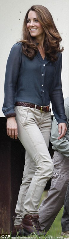 ZARA, £20: A practical outfit for trekking in the a Malaysian conservation area, Kate wears a blouse from High Street brand Zara with beige khaki pants, a brown belt and walking boots