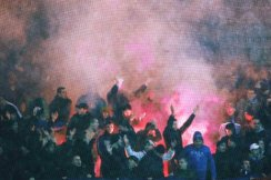 Reuters-.--.-Dinamo Zagreb supporters light flares after their UEFA Cup Group B soccer match defeat against Brann in Bergen