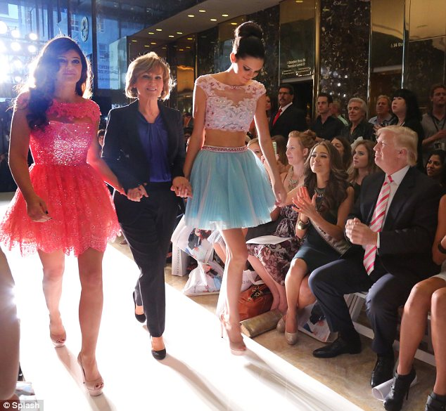 Curtain call: At the end of the show the sisters stepped out with the designer while being watched by Donald Trump (R)