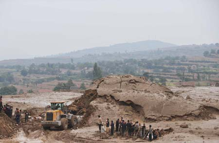 Eight more deaths were reported Tuesday morning in north China's Shanxi Province, bringing the death toll from the rain-triggered mud-rock flow that caused the collapse of a warehouse to 34, the local rescue headquarters said on Tuesday.