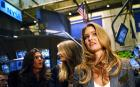 Sports Illustrated swimsuit issue cover model Bar Refaeli (C) tours the trading floor with other models just before ringing the closing bell at the New York Stock Exchange in New York