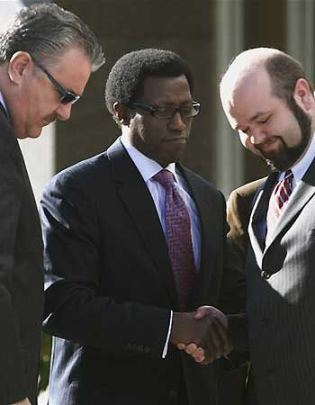 Feb. 2008: Wesley Snipes shakes hands with one of his defense attorneys, Robert Barns, right, as his lead defense attorney Robert Bernhoft stands at left