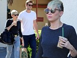 Ready to rip: Miley Cyrus makes a fashion statement in shredded jeans