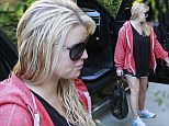 Sullen Jessica Simpson drags herself to the gym as her parents announce divorce amid shock claims her dad is gay