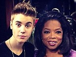'Me and Oprah just swaggin it out': Justin Bieber cuddles up to talk show host Winfrey as they wrap Next Chapter interview