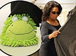 Mix and match: Oprah Winfrey went shopping at Morgane le Fay in New York City on Thursday sporting a comfortable pair of green frog slippers