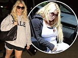 Grinning and winning: Jessica Simpson proved she's conquering the battle of the baby weight as she arrived at an LA gym on Thursday night