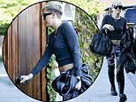 Miley Cyrus ensures she gets noticed in bizarre outfit... but it doesn't stop her getting locked out of recording studio