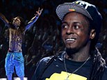 Lil Wayne hospitalised after suffering 'seizure-like symptoms' during a flight