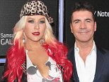 War of words: Christina Aguilera, pictured in LA on Thursday, has launched an attack on Simon Cowell