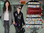 Birthday girl Kelly Osbourne doesn't need any more clothes for presents... as she arrives at Heathrow with LOTS of luggage