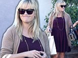 She can't stop shopping! Glowing Reese Witherspoon continues in her quest for a new post-baby wardrobe