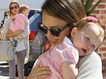 Stylish super mum Jessica Alba squeezes into skinny jeans and wedges as she shares a cute hug with baby Haven