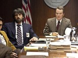 Hatching a plan: Ben Affleck, left, and Bryan Cranston in the new film Argo based on a true story