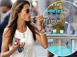That's how she does it! Slender Alessandra Ambrosio shows off her figure in bright skinny jeans as she tucks into non-fat treat