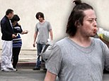 Talk about a car crash! Edward Furlong looks a shadow of his former self as he makes scruffy roadside display after prang