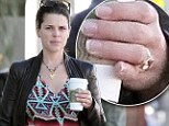 Three time's a charm? Twice-divorced Neve Campbell wears sparkler on her ring finger while grabbing coffee