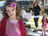 Movie star in the making! Alyson Hannigan's mini-me Satyana strikes a pose during their neighbourhood stroll
