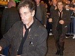 And the Oscar for most scruffy costume goes to: A shabbily dressed and bleary eyed Al Pacino greets fans outside theatre
