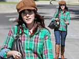 Zooey Deschanel hides her make-up free face underneath a quirky cap as she spends the day house hunting