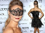 Masked beauty! Stacy Keibler is the belle of the Masquerade ball in a Gothic-inspired black corseted dress and filigree mask