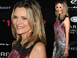The definition of pretty in pink: Michelle Pfeiffer looks half her 54 years as she shimmers at charity benefit