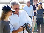 Snap happy: Harrison Ford and Calista Flockhart take photos for the family album as they watch their son play football