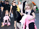 Unicorn princess! Angelina Jolie's daughter Vivienne gets into the Halloween spirit as actress takes her brood to a toy store