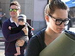 A moment on the lips: Hilary Duff enjoys breakfast with her husband and baby Luca... then hits a Pilates class