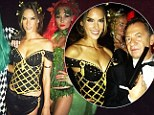 Golden goddess: Alessandra Ambrosio flaunts cleavage and pins in sexy black Grecian costume