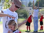 Setting a good example! Jennie Garth supports her girls at soccer match... sporting charity fundraising T-shirt for Afghan women