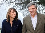 'Badge of acceptance': Carole and Michael Middleton, seen in 2010, hosted a shooting party over the weekend near their new £4.85million Berkshire mansion