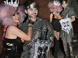 Christina Aguilera spills out of sexy Halloween costume and plants smacker on her knight in shining armour
