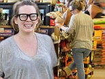 Back to work! Make-up free Hilary Duff back to mom mode day after donning Day of Dead costume for Halloween bash