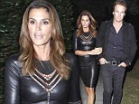 Looking frightfully good! Cindy Crawford leaves costumes to the kids and slips into leather dress for Halloween bash