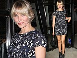 All about those legs! Cameron Diaz shows off her famous long pins in a printed mini dress at star-studded fashion affair