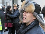 What a gent! Bruce Willis steps in to warm up co-star Mary-Louise Parker on set of Red 2... while Anthony Hopkins begins work on action movie sequel